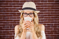 Gorgeous Blonde Hipster Drinking Out Of Take-away Cup Royalty Free Stock Image - 56799946