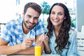 Cute Couple Sitting In Cafe Stock Photography - 56803282