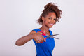 Young African American Woman Cutting Her Frizzy Afro Hair With S Stock Image - 56806711