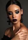 Beautiful Girl With Dark Hair With Bright Extravagant Makeup And Bijou Stock Photography - 56821072