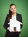 Business Woman Holding Paper House On Green Background Royalty Free Stock Photo - 56821505