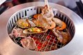 Mixed Roasted Meat And Seafood And Chopsticks On The BBQ Grill O Stock Photo - 56853380