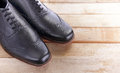 Leather Shoes On Wood Royalty Free Stock Photography - 56886857