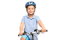 Little Boy With Blue Helmet Posing On A Bicycle Royalty Free Stock Photography - 56887857
