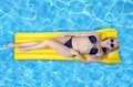 Woman Relaxing In A Pool Stock Photos - 56928213