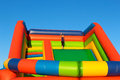 A Little Girl Stands On An Inflatable Trampoline. Stock Photo - 56940230