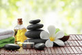 Essential Oil , Candle, Towel And Stones For Teraphy Stock Images - 56942374