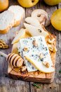 Blue Cheese With Slices Of Pear And Honey Stock Photography - 56946902