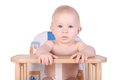 Adorable Baby In High Chair Isolated Royalty Free Stock Image - 56953166