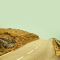 Empty Mountain Asphalt Road And Clear Blue Sky Stock Images - 56953454