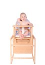 Adorable Baby In High Chair Isolated Royalty Free Stock Photography - 56953467