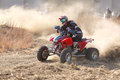 Quad Bike Kicking Up Trail Of Dust On Sand Track During Rally Ra Stock Photo - 56970380