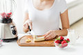 Close Up Of Woman With Blender Chopping Banana Royalty Free Stock Photography - 56986907