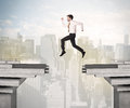 Energetic Business Man Jumping Over A Bridge With Gap Royalty Free Stock Images - 56996419
