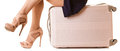Travel And Vacation. Female Legs With Suitcase Bag. Royalty Free Stock Image - 57000876