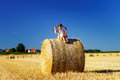 Funny Cute Little Girl Posing On The Haystack In Summer Field Royalty Free Stock Images - 57020689