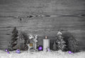 Grey Wooden Background With Handmade Reindeer, Trees And Violet Royalty Free Stock Photo - 57034385
