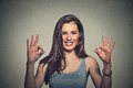 Optimistic Woman Giving Ok Sign Gesture With Two Hands Stock Photography - 57036222