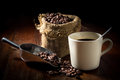 Coffee Beans In Metal Scoop And With Cup And Gunny Sack. Stock Image - 57037141