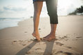 Closeup Barefoot Couple Legs At The Beach Royalty Free Stock Image - 57048826