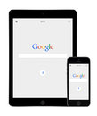 Google Search App On The Apple IPad Air 2 And IPhone 5s Displays Stock Images - 57059144