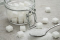 Sugar On Spoon And Glass Jar Stock Image - 57062091
