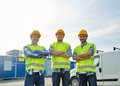 Happy Male Builders In High Visible Vests Outdoors Stock Photography - 57068642