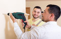 Two Skilled Men Doing Maintenance Stock Image - 57077421