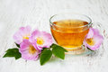 Cup Of Tea And Dogrose Royalty Free Stock Photography - 57081557