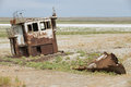 Rusted Remains Of Fishing Boat At The Sea Bed Of The Aral Sea, Aralsk, Kazakhstan. Stock Photography - 57106172