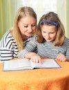 Happy Girl And Grandmother Studying. Royalty Free Stock Photography - 57109467