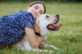 Portrait Of A Woman With Her Beautiful Dog Lying Outdoors Stock Images - 57114494