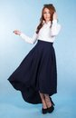 Beautiful Young Woman In A Long Blue Skirt Royalty Free Stock Photography - 57116737