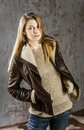 Young Long-haired Girl In A Leather Jacket With  Fur Collar And Jeans Royalty Free Stock Images - 57120849