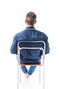 Back Of Young Man Sitting On Chair, Isolated Royalty Free Stock Photography - 57121347