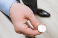 Businessman Tossing A Coin Stock Image - 57130221
