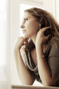 Sad Beautiful Woman Looking Out Window Royalty Free Stock Photography - 57149827