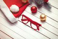 Santas Hat And Christmas Bubbles With Red Glasses Stock Photography - 57169612