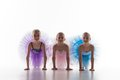 Three Little Ballet Girls Sitting In Tutu And Posing Together Royalty Free Stock Images - 57173489