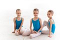 Three Little Ballet Girls Sitting And Posing Together Royalty Free Stock Photography - 57177857