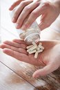 Close Up Of Man Pouring Pills From Jar To Hand Stock Images - 57179354