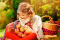 Happy Child Girl Sitting With Apples In Autumn Sunny Garden Stock Photography - 57180792