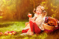 Happy Child Girl Eating Apples In Autumn Sunny Garden Royalty Free Stock Images - 57181639
