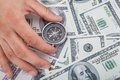 Hand Holding Compass On Us Currency Stock Photos - 57197403