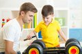Kid Boy And His Father Repair Toy Lorry Stock Photos - 57227593