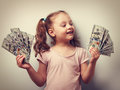 Happy Kid Girl Holding Cash Dollars And Looking With Smile. Vint Royalty Free Stock Image - 57236306