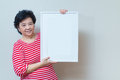 Asian Woman Holding Empty White Picture Frame In Studio Shot, Sp Royalty Free Stock Photography - 57262027