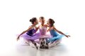 Three Little Ballet Girls Sitting In Tutu And Posing Together Stock Photos - 57271493
