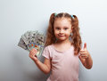 Happy Rich Kid Girl Holding Money And Showing Thumb Up Sign Royalty Free Stock Image - 57282466