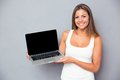 Happy Girl Showing Blank Laptop Screen Royalty Free Stock Images - 57305859